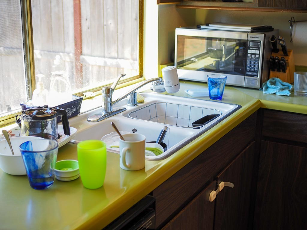 messy sink before company comes over for motivation to clean
