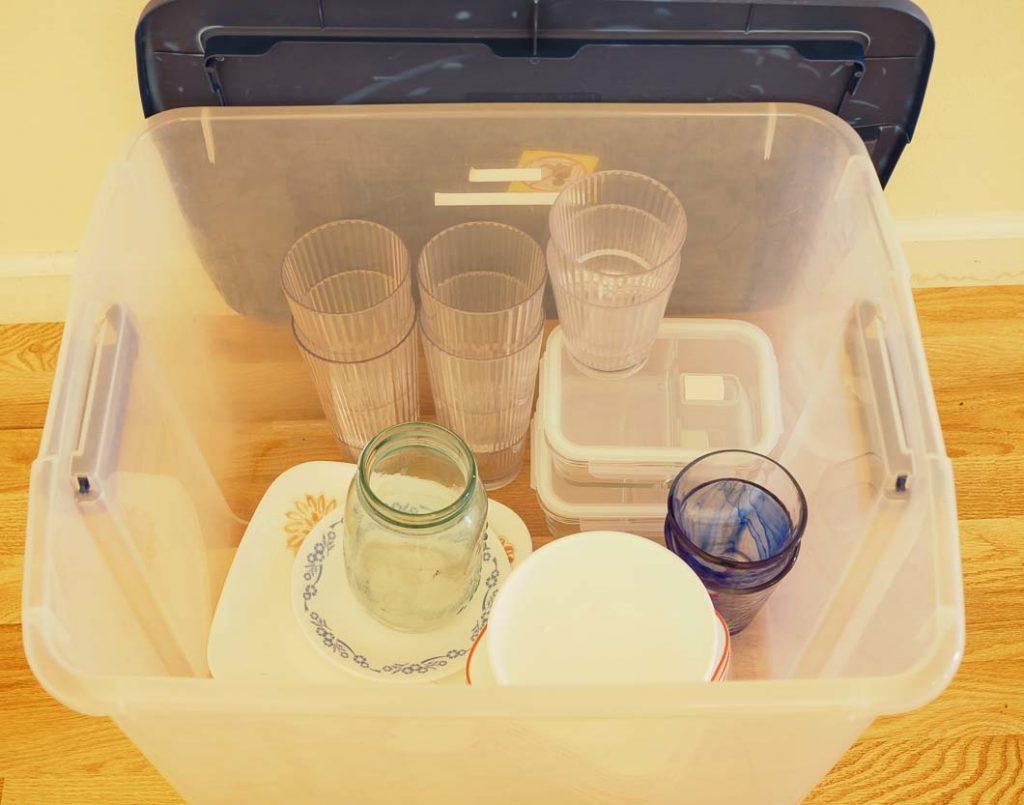 decluttering fun idea_ clear open bin with decluttered items in